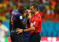 Bruno Martins of Netherlands gestures to referee Nicola Rizzoli that he was headbutted by Diego Costa of Spain