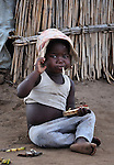 "A girl in Dickson, a village in southern Malawi that has been hard hit by drought in recent years, leading to chronic food insecurity, especially during the ""hunger season,"" when farmers are waiting for the harvest."