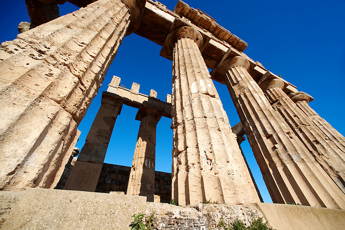 Greek Dorik columns at the  ruins of Temple F at Selinunte, Sicily photography, pictures, photos, images & fotos. 71