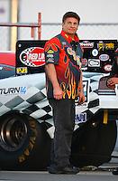 Feb 13, 2016; Pomona, CA, USA; Corey Lee , crew member for NHRA funny car driver Jim Campbell during the Winternationals at Auto Club Raceway at Pomona. Mandatory Credit: Mark J. Rebilas-USA TODAY Sports