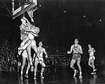 26 MAR 1952:  Kansas and St. John's matched up for the NCAA Men's National Basketball Final Four in Seattle, WA at the Edmundson Pavilion. Two unidentified players collide at the basket during the game. Kansas defeated St. John's 80-63. Photo By Rich Clarkson