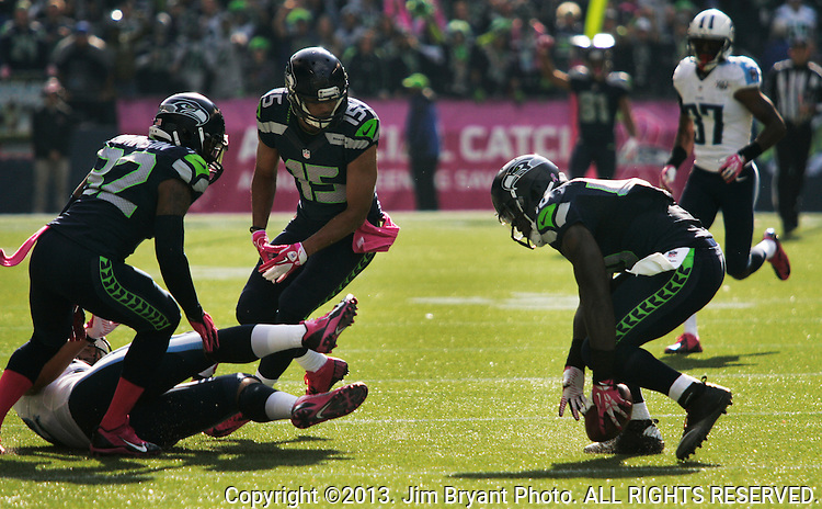 Seattle Seahawks fullback Derrick Coleman picks up a Tennessee Titians fumble at CenturyLink Field in Seattle, Washington on October 13, 2013. The Seattle Seahawks beat the Titians  20-13.   ©2013. Jim Bryant Photo. All Rights Reserved.