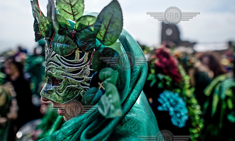 Participants at a Jack in the Green festival. The festival is part of a recent revival of an older custom where people would wear frameworks covering much of their bodies which were decked out in foliage. The custom is connected to English May Day parades that herald  the coming of summer.
