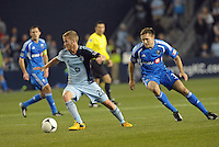 Oriol Rosell (20) midfield Sporting KC goes past Andrew Wenger...Sporting Kansas City defeated Montreal Impact 2-0 at Sporting Park, Kansas City, Kansas.