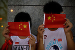 Chinese Olympic fans wait to catch a glimpse of the opening ceremony fireworks in Beijing, China on Friday, August 8, 2008.  Kevin German