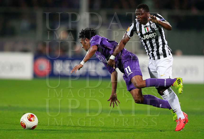 Calcio, ritorno degli ottavi di finale di Europa League: Fiorentina vs Juventus. Firenze, stadio Artemio Franchi, 20 marzo 2014. <br /> Fiorentina midfielder Juan Cuadrado, of Colombia, and Juventus midfielder Kwadwo Asamoah, of Ghana, right, fight for the ball during the Europa League round of 16 second leg football match between Fiorentina and Juventus at Florence's Artemio Franchi stadium, 20 March 2014. Juventus won 1-0 to advance to the round of eight.<br /> UPDATE IMAGES PRESS/Isabella Bonotto