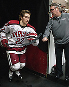Devin Tringale (Harvard - 22), John O'Donnell (Harvard - Equipment Manager) - The visiting Boston College Eagles defeated the Harvard University Crimson 5-1 on Wednesday, November 20, 2013, at Bright-Landry Hockey Center in Cambridge, Massachusetts.