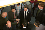 Mayor Chris Clark, center, mingles with guests at a reception in his honor Jan. 7.