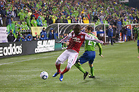 Portland Timbers midfielder Kalif Alhassan, left, gets position on Seattle Sounders FC forward Roger Levesque during play at Qwest Field in Seattle Saturday May 14, 2011. The game ended 1-1 draw.