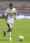 UNAM Pumas forward Jose Luis Lopez drives the ball during his soccer match with UANL Tigres at the University Stadium in Mexico City, April 23, 2006. UNAM Pumas tied 1-1 to UANL Tigres... Photo by © Javier Rodriguez