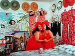 3/ 24/91 Al Diaz/Herald staff--Twin artists, Haydee and Sahara Scull in their South Beach home in 1991. the Cuban artists colaborate to create three dimensional paintings.
