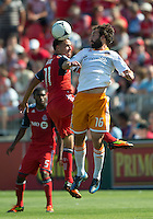 July 28, 2012: Houston Dynamo midfielder Adam Moffat #16 and Toronto FC midfielder Luis Silva #11in action during a game between Toronto FC and the Houston Dynamo at BMO Field in Toronto, Ontario Canada..The Houston Dynamo won 2-0.