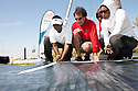 Pictures of Al Thuraya Bank Muscat all women sailing team, skippered by Dee Caffari. Shown here tuning sails prior to the race start in Bahrain..Credit: Lloyd Images