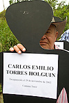 A man displays a poster with a picture of her missing son in commemoration of the National Movement of Victims of State Crimes, MOVICE, commemorate this April 9 as the Day of Memory and Solidarity with Victims of state crimes in this time of vital importance to the country because it was from when triggered, significantly, the political conflict, social and armed, that today, after decades, continues in the form of persecution, threats and harassment against land claimants leaders and human rights defenders. In the district there are 13 mass graves containing more than 1000 dead buried in a dump that works in the area. The close calls that dump MOVISE and declare the area as a cemetery. In Colombia, this time away from a transitional or post. More than 60 leaders killed lands (at least 26 of these victims killed between 2010 and 2011), the reengineering of paramilitarism in over 400 municipalities, more than 1,400 displaced people killed since 2007, a development model based on dispossession and displacement. In Medellín, Colombia. 09/04/2012. Photo by Fredy Amariles/VIEWpress.