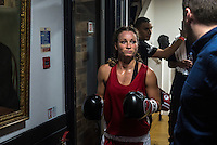 Emily Williams enters the arena at a white collar boxing event at the London Irish Centre where the 'Carpe Diem' boxing event is taking place. <br /> <br /> 'White-collar boxing' is a growing phenomenon amongst well paid office workers and professionals and has seen particular growth in financial centres like London, Hong Kong and Shanghai. It started at a blue-collar gym in Brooklyn in 1988 with a bout between an attorney and an academic and has since spread all over the world. The sport is not regulated by any professional body in the United Kingdom and is therefore potentially dangerous, as was proven by the death of a 32-year-old white-collar boxer at an event in Nottingham in June 2014. The London Irish Centre, amongst other venues, hosts a regular bout called 'Carpe Diem'. At most bouts participants fight to win. Once boxers have completed a few bouts they can participate in 'title fights' where they compete for a replica 'belt'.