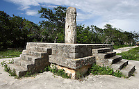 Structure 12 with Monolith, Platform of 1,4 meters high with four staircase on each side and the monoilith in the center, Dzibilchaltun (500 BC - 1500 AD), Yucatan, Mexico. Picture by Manuel Cohen
