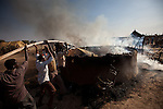 Men put out a fire in Abyei.