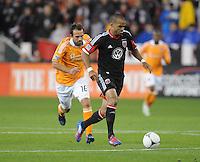 D.C. United forward Maicon Santos (29) runs with the ball follow by Houston Dynamo midfielder Adam Moffat (16) D.C. United defeated The Houston Dynamo 3-2 at RFK Stadium, Saturday April 28, 2012.
