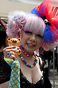 April 29, 2012, Tokyo, Japan -  A Japanese woman wears rainbow neckless at Yoyogi Park. The first Tokyo Rainbow Pride parade started from Yoyogi Park and went around the Harajuku area.  (Photo by Rodrigo Reyes Marin/AFLO) (JAPAN)   .