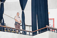 A police officer stands in the empty gym after a campaign rally for Democratic presidential nominee Hillary Clinton in the Theodore R. Gibson Health Center at Miami Dade College-Kendall Campus in Miami, Florida, USA.
