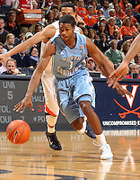 Jan. 8, 2011; Charlottesville, VA, USA;  North Carolina Tar Heels guard Dexter Strickland (1) drives past Virginia Cavaliers guard Mustapha Farrakhan (2) during the game at the John Paul Jones Arena. Mandatory Credit: Andrew Shurtleff