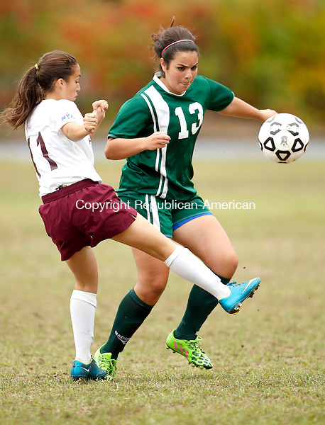 Waterbury, CT- 30 September 2015-093015CM06-  Sacred Heart's Adalena Francis, left, and Holy Cross' Emma Gargano battle for the ball during their NVL matchup at Bucks Hill Park in Waterbury on Wednesday.    Christopher Massa Republican-American