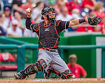 22 September 2013: Miami Marlins catcher Jeff Mathis in action against the Washington Nationals at Nationals Park in Washington, DC. The Marlins defeated the Nationals 4-2 in the first game of their day/night double-header. Mandatory Credit: Ed Wolfstein Photo *** RAW (NEF) Image File Available ***