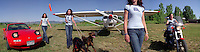 Marijke Unger with her dogs, car, airplane and motorcycle at Antique Field in Longmont, Colo.