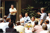 United States Representative Cleve Benedict (Republican of West Virginia), standing right, poses a question to United States President Ronald Reagan, stand left, following lunch at Camp David, near Thurmont, Maryland, on Sunday, August 15, 1982..Mandatory Credit: Michael Evans - White House via CNP