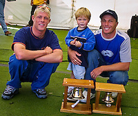 Mick Fanning (AUS) won the 2001 Rip Curl Pro at Bells Beach, Victoria, Australia. Fanning was a sponsors wildcard and stormed the field, defeating Danny Wills (AUS) in the finals.  Fanning and Wills, with is son Jayden, pose withe the famous Bells trophies. Photo: joliphotos.com