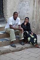 Stone Town, Zanzibar, Tanzania.  Zanzibari African Couple.