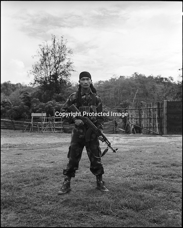24 year old Corporal Jet Lee Dimasa a.k.a. Kung fu Master poses with an AK 56 assault rifle at the Basabari camp of the ceasefire terrorist group Dima Halim Daoga (DHD) in Mibang in North Cachar hills of Assam, India.