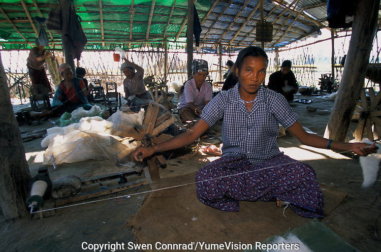 Under UNHCR protection, the life of 135000 Bhutan refugees in the 7 camp (near Damak, Nepal). Womans and mens are spinning woollen for few rupees..-The full text reportage is available on request in Word format