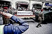 Krakow 18/04/2010 Poland<br /> People mourning the tragic death of President Lech Kaczynski and his wife in Krakow before funeral.<br /> on pictures: The flag-draped coffins were pulled by Humvees, as soldiers in berets slowly marched beside.<br /> Photo: Adam Lach / Napo Images for The New York Times<br /> <br /> Zaloba po tragicznej smierci Prezydenta Lecha Kaczynskiego i jego malzonki w Krakowie przed pogrzebem.<br /> na zdjeciu: trumna z Maria Kaczynska.<br /> Fot: Adam Lach / Napo Images for The New York Times