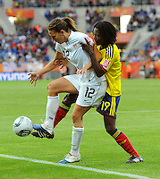 Lauren Cheney (l) of team USA and Fatima Montano of team Columbia during the FIFA Women's World Cup at the FIFA Stadium in Sinsheim, Germany on July 2nd, 2011.