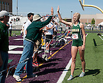 Brittany Owens receives a high five from Borah jump coach Hugo Jacobsmeyer after breaking her 2010 state meet long jump record of 19-01 with a jump of 19-05.50 during the 5A Idaho Track and Field Championships on May 19, 2012.  Owens ended her high school track and field career as a six time state champion winning the long jump and triple jump titles the past three years.