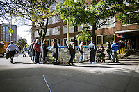 Voters on line outside of a polling location in Chelsea in New York to cast their ballots  on election day on Tuesday, November 6, 2012. Voters who were displaced by Hurricane Sandy will be allowed to walk into any polling location and submit an affidavit ballot..  (© Richard B. Levine)