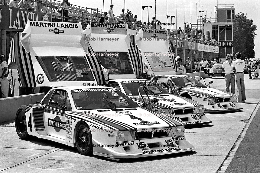 WATKINS GLEN, NY - JULY 12: The Martini Racing Lancia Beta Montecarlo team cars are lined up in the pit lane before the Watkins Glen 6 Hour FIA World Sports Car Championship race at the Watkins Glen Grand Prix Race Course near Watkins Glen, New York, on July 12, 1981.