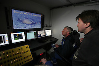 Fredrik S&oslash;reide watches as Thor Olav Sperre operates the ROV towards ceramics found on the seaved. &copy;Fredrik Naumann/Felix Features