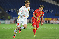 Cardiff City Stadium, Friday 11th Oct 2013. Declan John of Wales battles with Stefan Ristovski of Macedonia during the Wales v Macedonia FIFA World Cup 2014 Qualifier match at Cardiff City Stadium, Cardiff, Friday 11th Oct 2014. All images are the copyright of Jeff Thomas Photography-07837 386244-www.jaypics.photoshelter.com