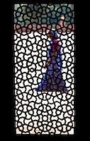A woman walks by, framed by the silhouette of a screened window inside humayun's tomb.