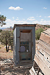Corrugated metal outhouse