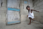A girl plays hopscotch in Batey Bombita, a community in the southwest of the Dominican Republic whose population is composed of Haitian immigrants and their descendents.