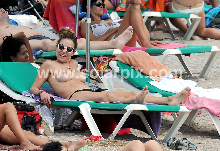 ** EXCLUSIVE PICTURES FROM SOLARPIX.COM**.**UK MAGAZINE PUBLICATION ONLY**.**NO PUBLICATION PERMITTED UNTIL EXCLUSIVE FEE HAS BEEN AGREED*.**WORLDWIDE SYNDICATION RIGHTS EXCLUDING SPAIN - NO PUBLICATION IN SPAIN**..Frank Lampard's ex, Elen Rives showed Frank just what he is missing while on holiday in Ibiza this week. The Spanish beauty was on the beach with daughters Luna (7) and Isla (5) and a mystery man. At one stage, Elen joked around and pulled her bikini bottoms down to reveal her bottom. She looked relaxed while puffing on a cigarette and had a bite to eat on her sunbed with the handsome mystery man..This pic:    Elen Rives. JOB REF:    11851      RAM/SF       DATE: 05.08.10..**MUST CREDIT SOLARPIX.COM OR DOUBLE FEE WILL BE CHARGED**.**MUST AGREE FEE BEFORE ONLINE USAGE**.**CALL US ON: +34 952 811 768 or LOW RATE FROM UK 0844 617 7637**