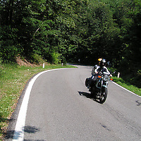 Tratto di strada nei boschi nelle vicinanze di Colle Brianza..Bikers on road through the woods near Colle in Brianza