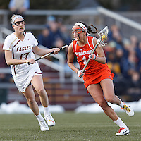 Syracuse University attacker Alyssa Murray (1) on the attack as Boston College midfielder Mikaela Rix (17) defends.  Syracuse University (orange) defeated Boston College (white), 17-12, on the Newton Campus Lacrosse Field at Boston College, on March 27, 2013.