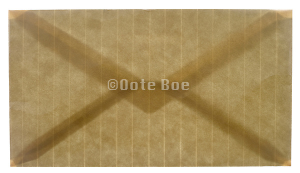 a closed stripped brown colored envelope
