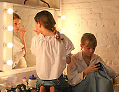 "Getting ready in the dressing room.  Drama group for 8-13s rehearsing a production of ""Alice"" in the Mill Studio at the Yvonne Arnaud Theatre, Guildford, Surrey."