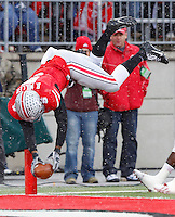 Ohio State Buckeyes quarterback Braxton Miller (5) flips into the end zone for the Buckeyes second touchdown of the day against indiana at Ohio Stadium in Columbus, Ohio on November 23, 2013.  (Chris Russell/Dispatch Photo)