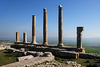 Low angle view of a row of columns from the Temple of Saturn, built around 200 A.D., in Dougga, Tunisia, pictured on January 31, 2008, in the morning. Dougga has been occupied since the 2nd Millennium BC, well before the Phoenicians arrived in Tunisia. It was ruled by Carthage from the 4th century BC, then by Numidians, who called it Thugga and finally taken over by the Romans in the 2nd century. Situated in the north of Tunisia, the site became a UNESCO World Heritage Site in 1997. This temple was previously the site of the Punic Temple of Baal. The entrance had four Corinthian columns which remains are still visible. Picture by Manuel Cohen.